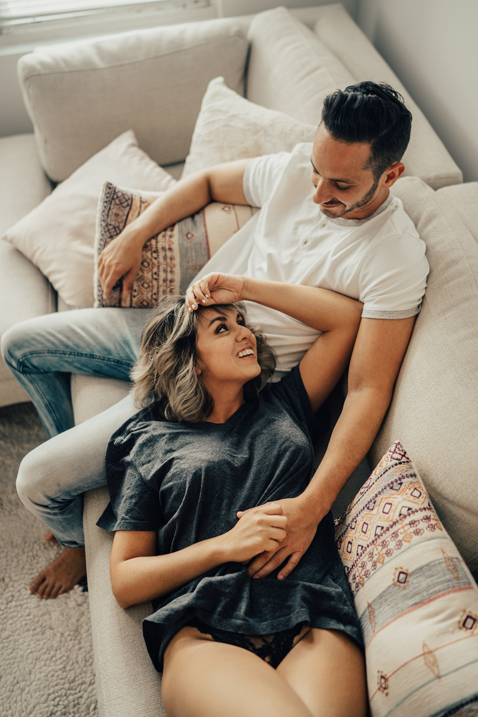 Intimate lovers embrace stock photo. Image of foreplay